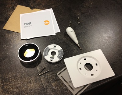 All the things that come with your Nest. The Nest itself, the wallplates, instructions and screwdriver