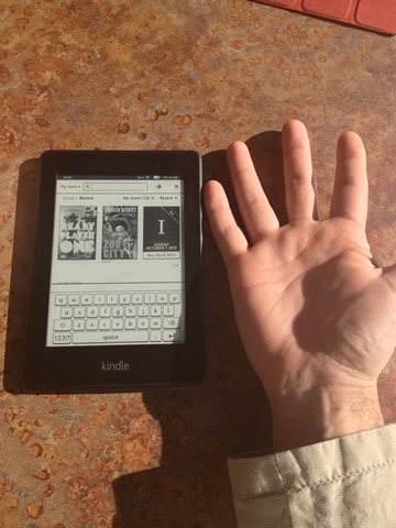 My hand compared to the Kindle Paperwhite
