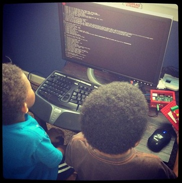Two little boys on a Raspberry PI