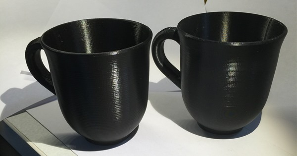 Coffee Cup 3D Print from a Printrbot Simple Metal on one side and a Stratasys uPrint SE Pro on the other