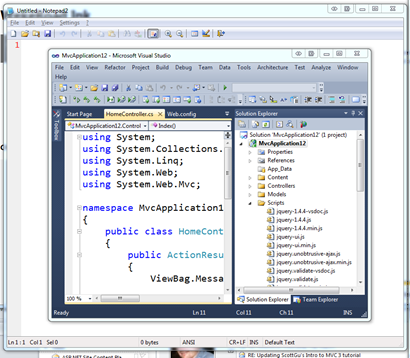 Notepad open behind Visual Studio